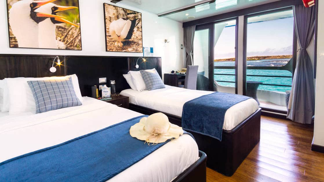 Junior Suite with 2 twin beds and door to balcony aboard Natural Paradise Galapagos small ship
