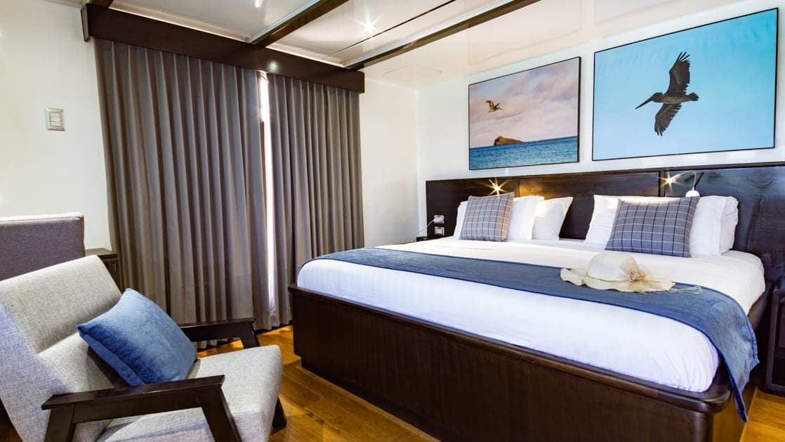Upper Deck Suite with king bed and private balcony aboard Natural Paradise Galapagos small ship