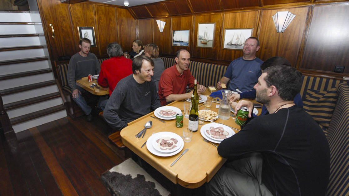 guests eating and talking aboard the noorderlicht