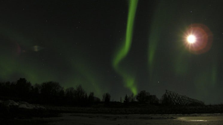 northern lights and full moon in northern norway