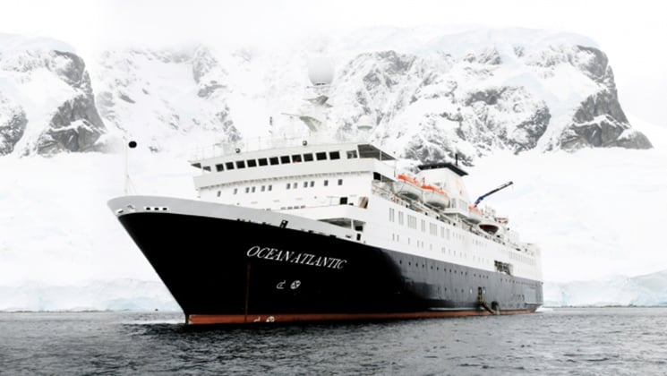 ocean atlantic polar vessel on an overcast day with snow in the background