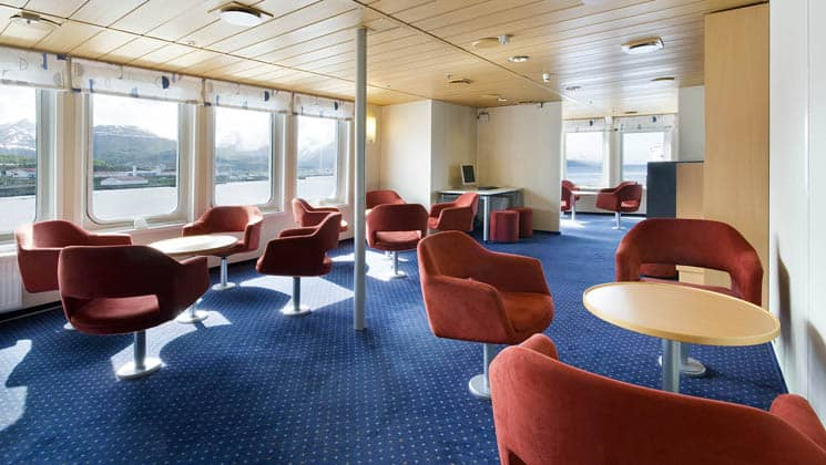 ocean nova lounge library with red chairs, tables and blue carpet