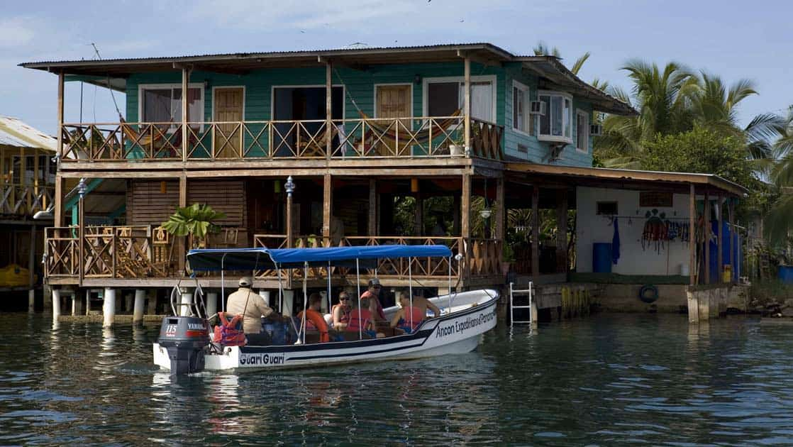 skiff full of adventure travelers on the water in bocas del toro on the Panama Discovery land tour