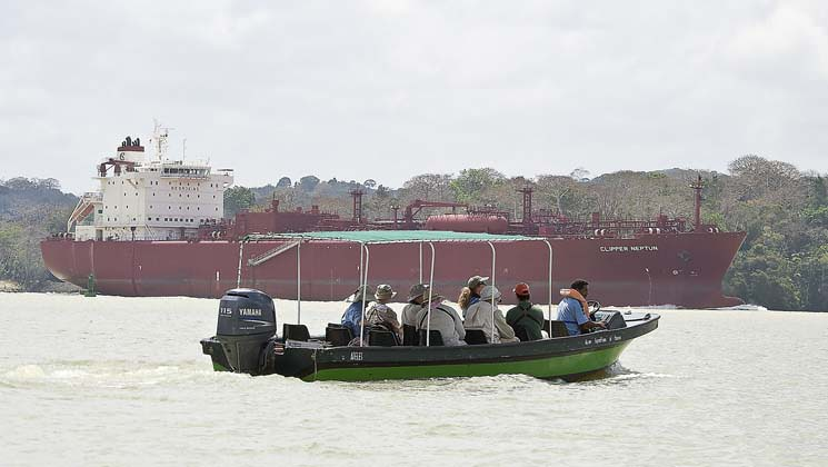 group of adventure travelers takes a boat ride around the panama canal on the discovery land tour