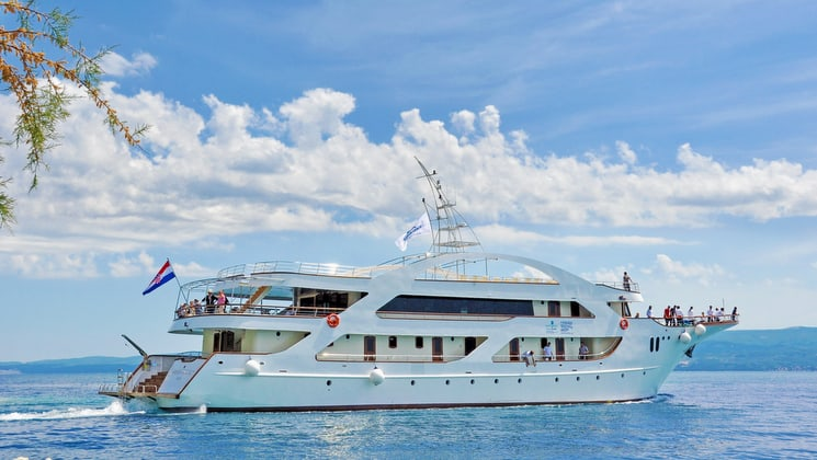the president luxury yacht cruising in the mediterranean on a sunny day