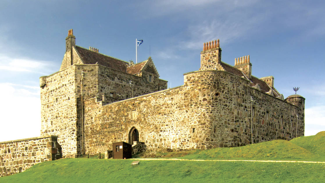 Duart Castle home of the Maclean clan Isle of Mull in Scotland, with green grass around