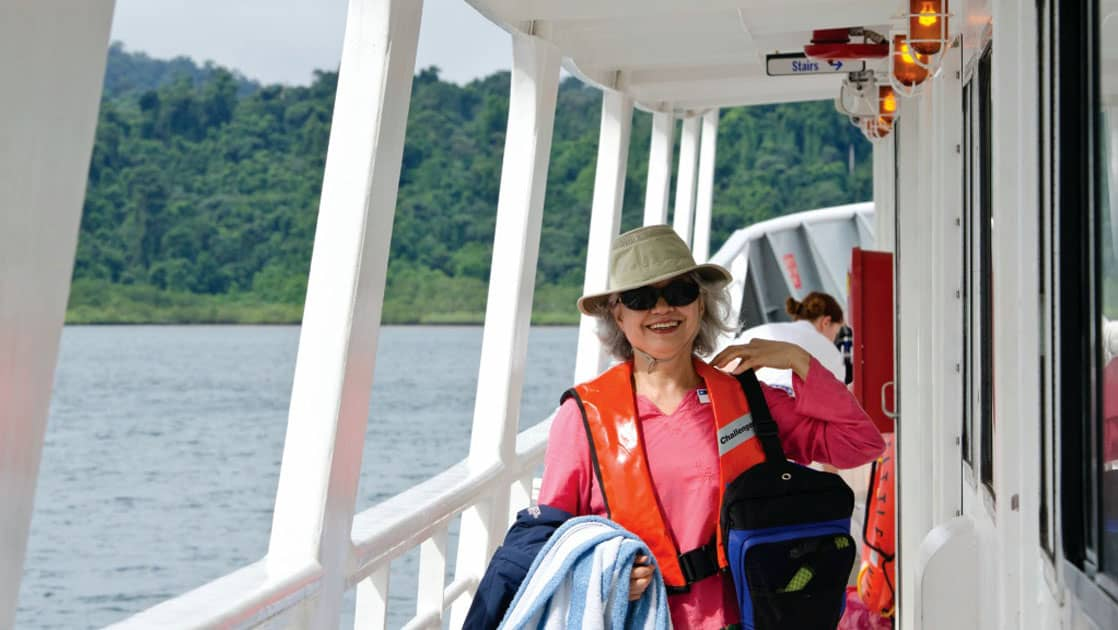 Woman with life jacket and day pack near balcony of National Geographic Sea Bird expedition ship
