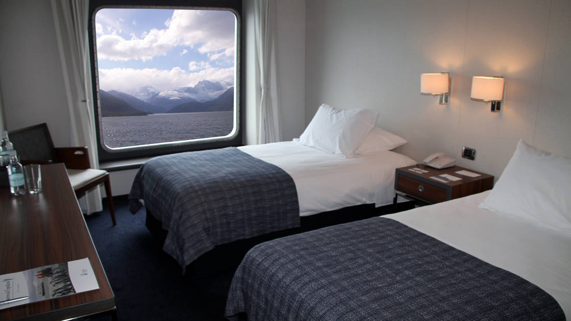 Category AA cabin aboard Stella Australis with twin beds.
