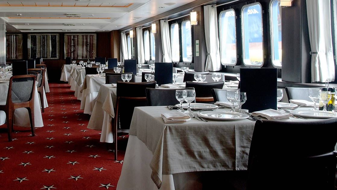 Dining room tables aboard Stella Australis.