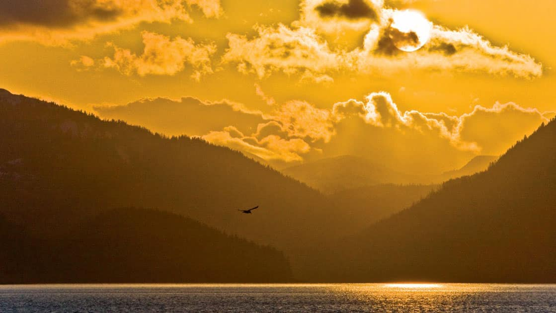 Orange sunset on Chichagof Island from Peril Strait, Southeast Alaska in the springtime