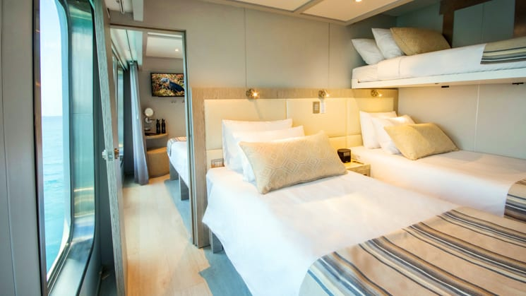 triple cabin with 3 beds and an adjoining room aboard the theory yacht