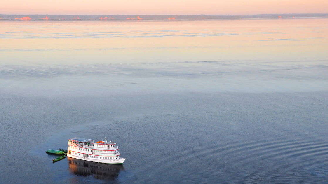 aerial view of the small ship tucano cruising on the rio negro during dawn