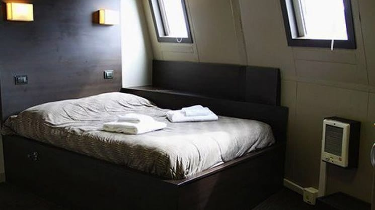 Suite Twin cabin aboard Ushuaia with double bed.