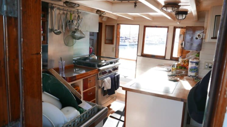 westward galley with stove, counter, knives and window