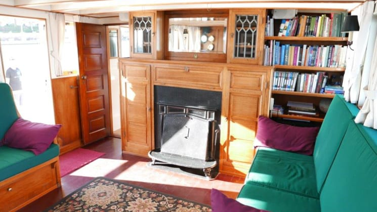 westward salon with couch, books and fireplace
