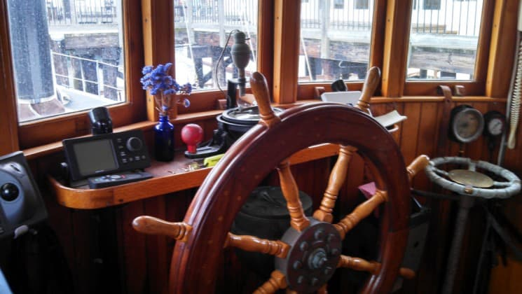 westward bridge with wooden steering wheel and instraments