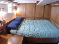 Cabin 4 with a desk with drawers and storage under the bunk aboard the westward.