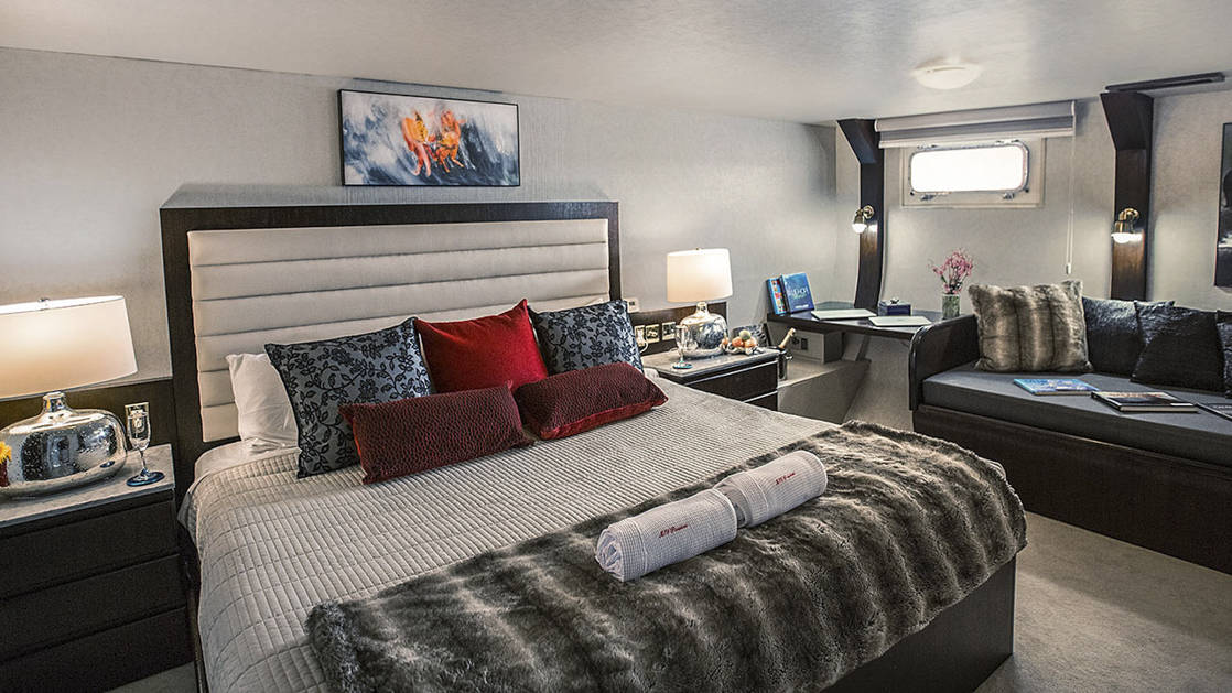 VIP Suite with King bed and sofa aboard WildAid's Passion