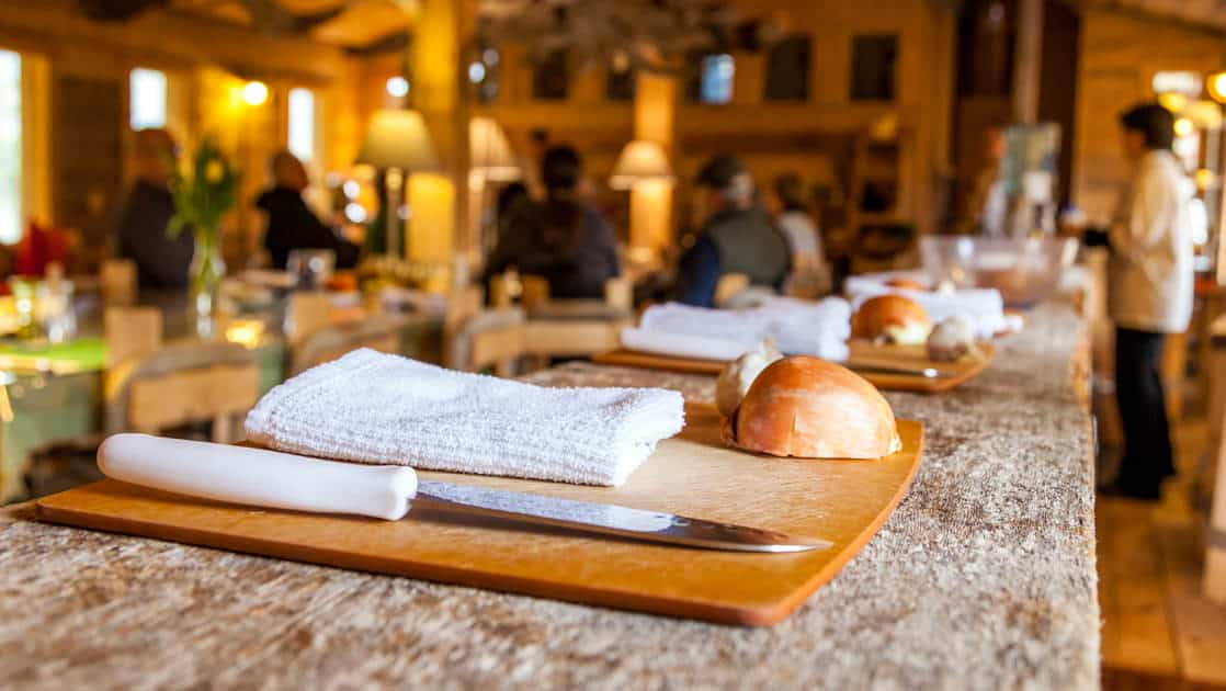 Bread and cheese are served on a cutting board for cooking school at Winterlake Lodge, an Alaska wilderness resort