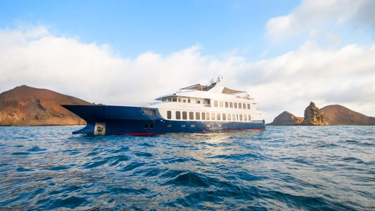 One of the Origin and Theory luxury cruise boats navigates passage through the galapagos islands