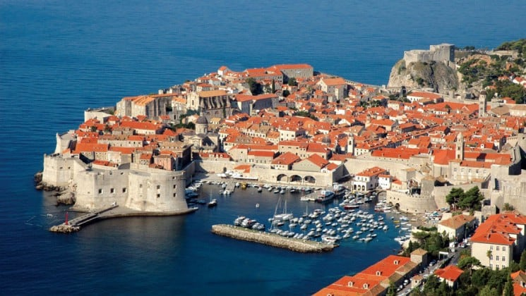 An aerial view of the port and red-tiled roof architecture in dubrovnik, croatia