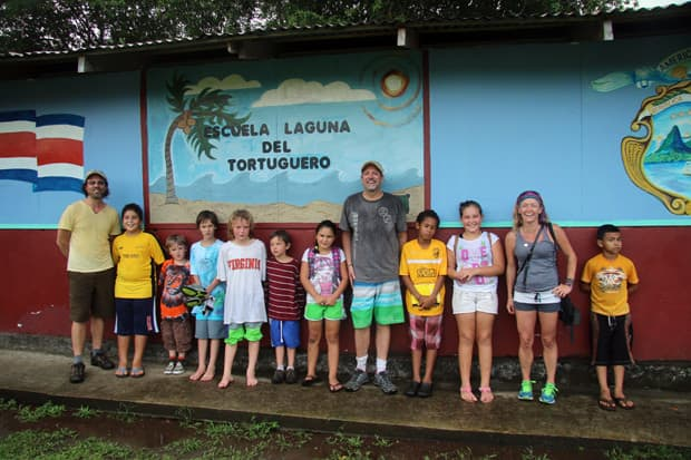 Travelers in Costa Rica visiting a local elementary school in Tortugero.