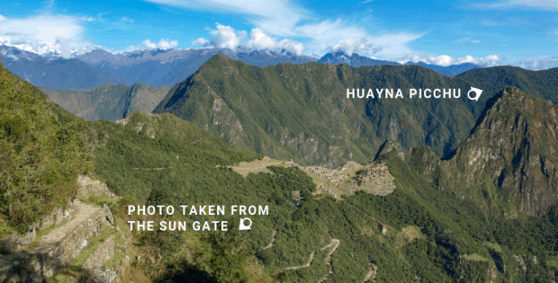 View from the Sun Gate with arrow showing location of Huayna Picchu at Machu Picchu.