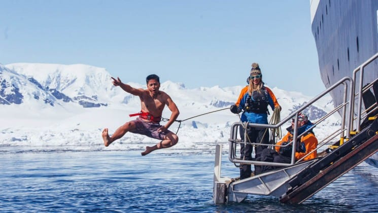 A passenger on crossing the antarctic circle jumps overboard to take the polar plunge