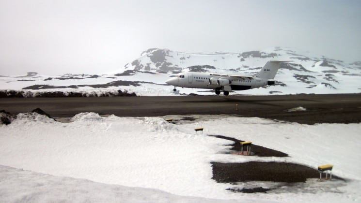 An airplane takes off from a strip in antarctica