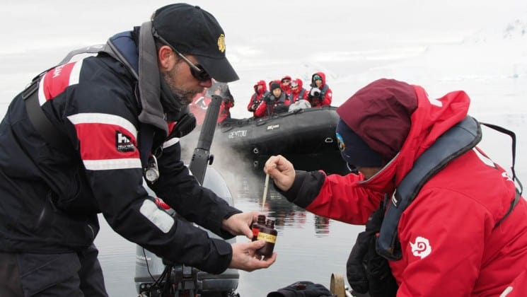 Passengers on the expedition study plankton in antarctica