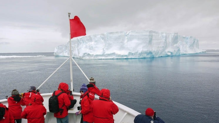 The bow of the Expedition ship in the Quest to the Antarctic Circle approach an iceberg