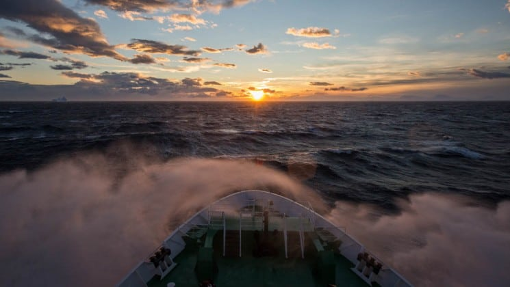 The sunset in antarctica, as seen from the bow of the ship on the spirit of shackleton aboard expedition cruise