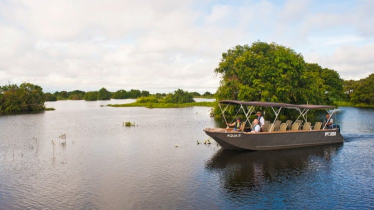 A boat motors guests down the Mekong River in Cambodia