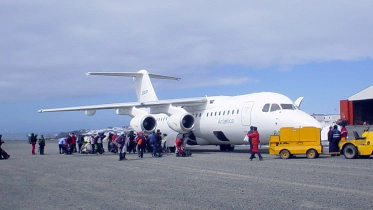 Passengers on the Polar Circle Air Cruise load an airplane on the tarmac, en route to Antarctica
