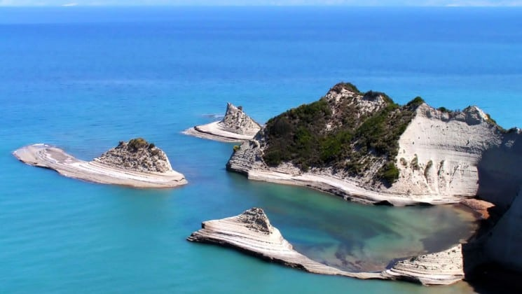 Cape Drastis in Corfu, with islands in the middle of the turquoise ocean between the adriatic and ionian seas