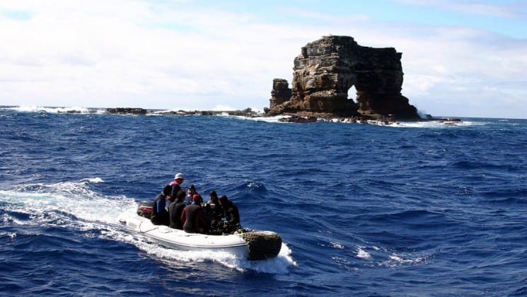 Darwin's arch is a rocky cliff that juts out of the ocean at the Galapagos islands