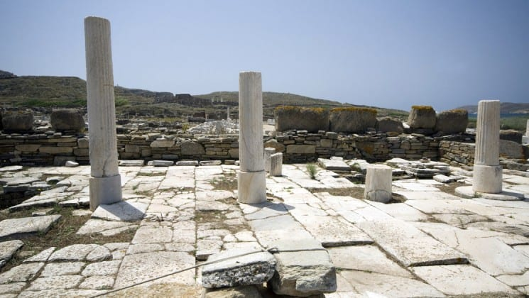ancient greek ruins and pillars in delos, an island in greece