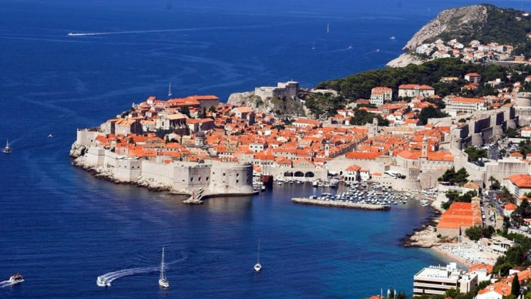 A view of dubrovnik with red tiled roofs and a harbor in the adriatic sea