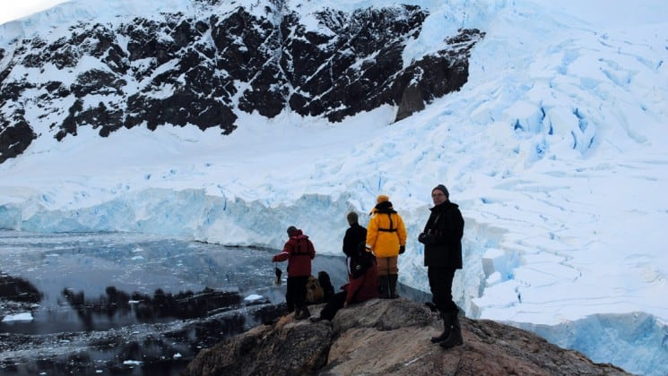 Passengers from the polar circle cruise and expedition explore antarctica's snow fields and icebergs
