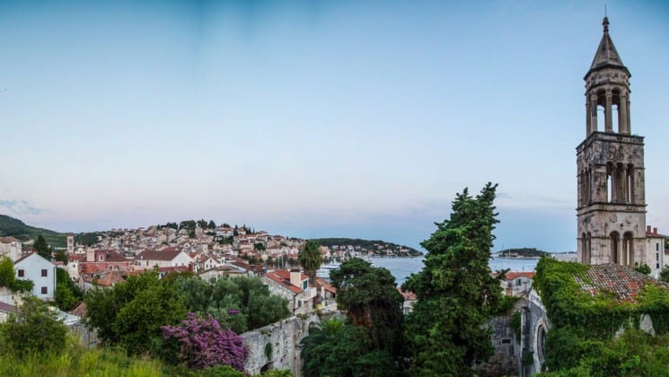 the view of Hvar, an island in croatia, with mediterranean architecture, red tiled roofs, and a pristine ocean