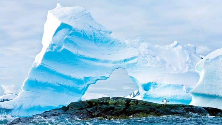 An iceberg rises up from the ocean in antarctica, as seen from the national geographic explorer