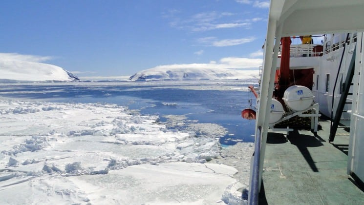 Looking out from the side of the adventure cruise ship with weddell sea emperor penguin voyage toward the ocean and icebergs in antarctica