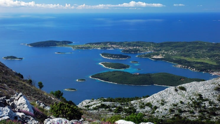 Islands in the adriatic sea with lush green plants and rocky bluffs
