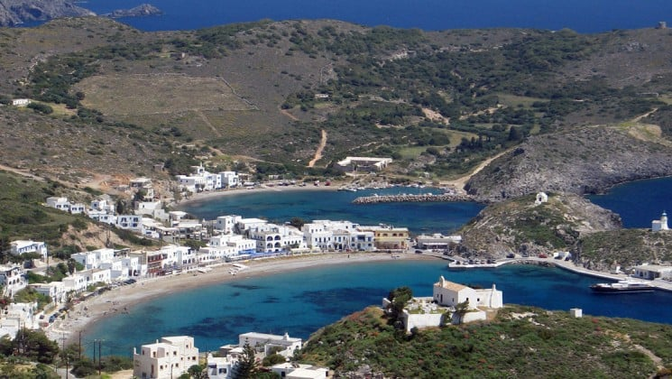 An aerial view of the clear waters and white stones at the port in kythira, an island in greece