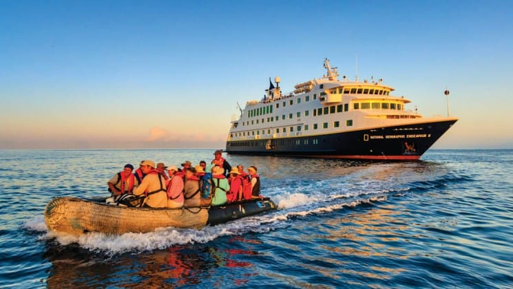 A zodiac boat takes passengers from the National Geographic Endeavour II to the Galapagos Islands for a day of wildlife, flora, and fauna exploration