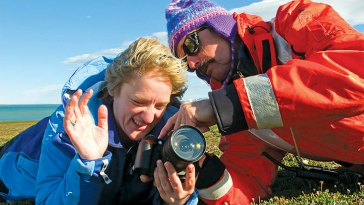 two people look into a camera for a photography lesson on the national geographic voyage to the northeast passage and arctic circle