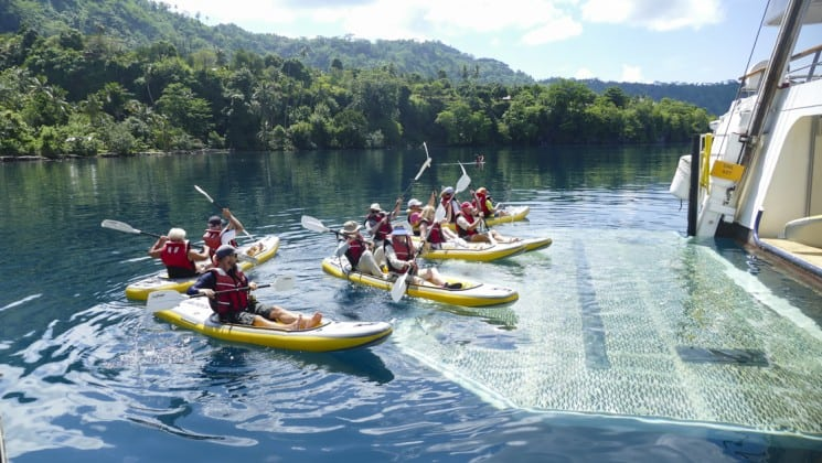 pacific islands guests on the frontier lands small ship cruise take a kayak excursion to explore the coastline of papua new guinea