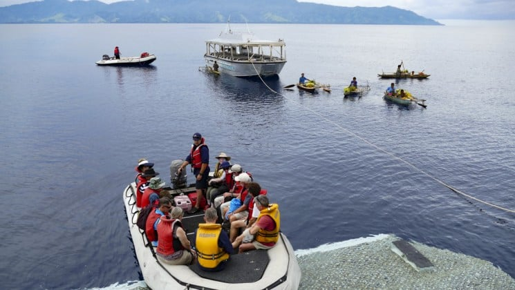 passengers on the frontier lands papua new guinea cruise load a boat in the pacific islands