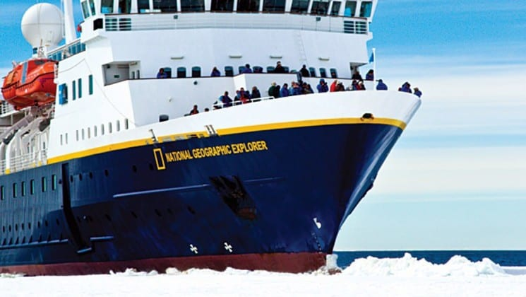 The 148-guest National Geographic Explorer cuts through the ocean and navigates passage through icebergs in antarctica