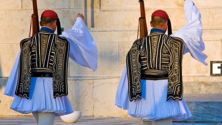 Two soldiers in uniform stand before parliament in athens greece